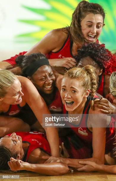 Helen Housby who scored in the final second and her England teammates celebrate at full time and winning the Netball Gold Medal Match between England...