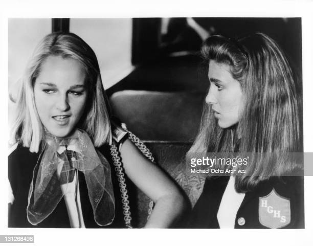 Helen Hunt and Sarah Jessica Parker confer during daily bus ride to their all girl Catholic School in a scene from the film 'Girls Just Want To Have...