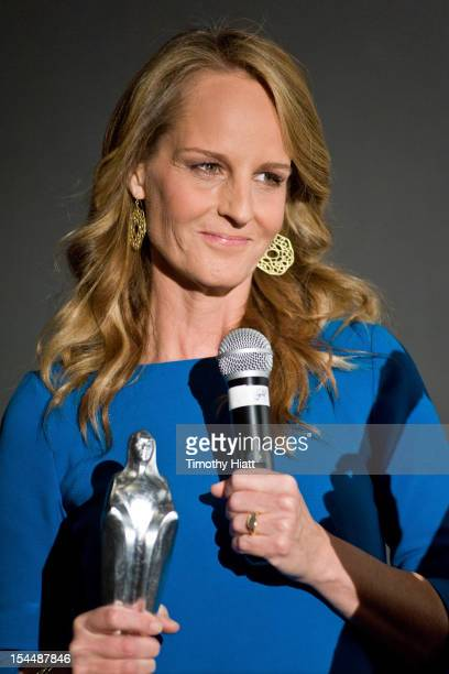 Helen Hunt receives the Silver Hugo award at The Sessions premiere during the 48th Chicago International Film Festival at the AMC River East 21 movie...
