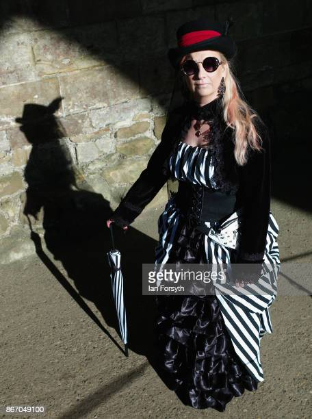 Helen Hutson-Pope from Surrey poses for the camera in Whitby Abbey during the Whitby Goth Weekend on October 27, 2017 in Whitby, England. The Whitby...