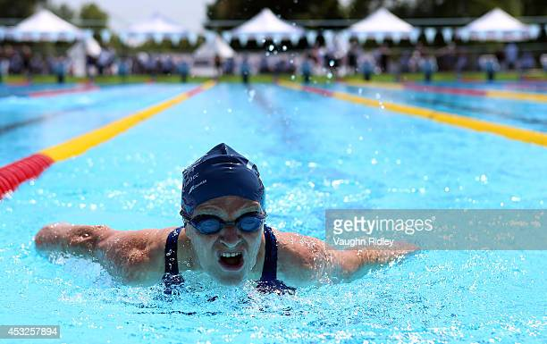 Helen Jacques of Canada competes in the Women's 100m Butterfly at Parc JeanDrapeau during the 15th FINA World Masters Championships on August 06 2014...