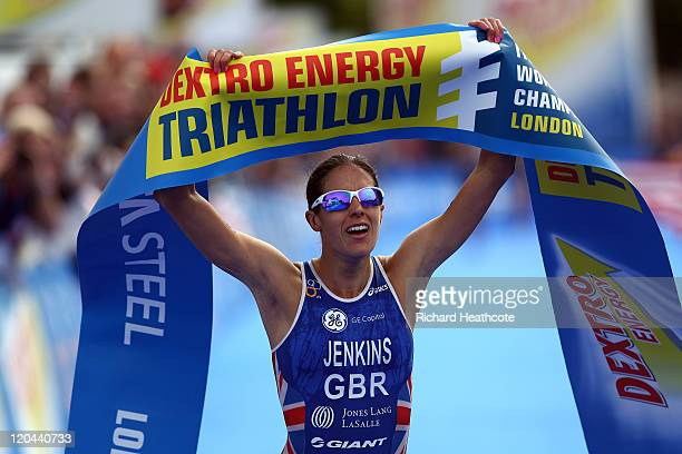 Helen Jenkins of Great Britian celebrates as she crosses the line to win the Women's Elite race during day one of the Dextro Energy Triathlon ITU...