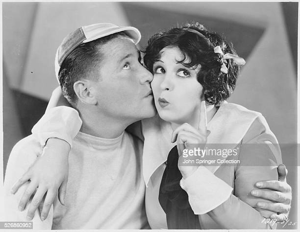 Helen Kane in the role of Helen Fry receives a kiss from Jack Oakie as TapTap Thoompson in the 1929 musical romance Sweetie