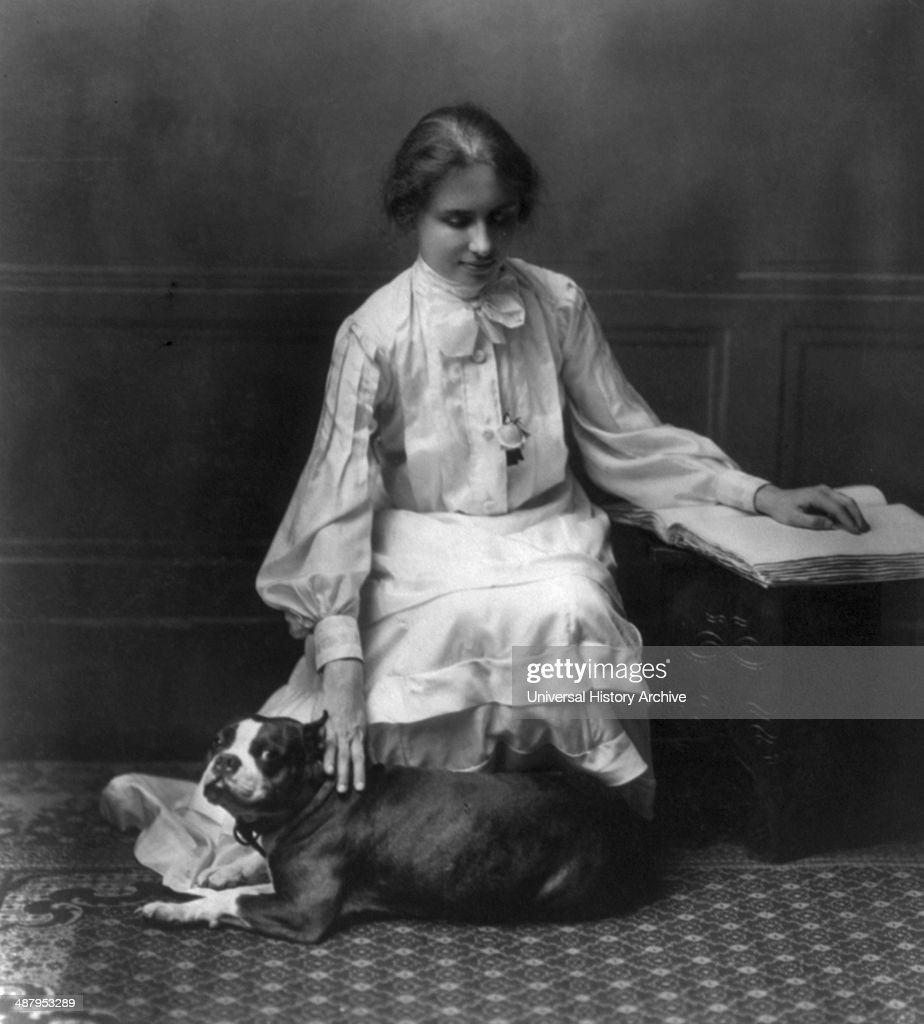 Helen keller stock photos and pictures getty images helen keller 18801968 kneeling facing right right hand on dog left hand on book 1904 helen thecheapjerseys Images