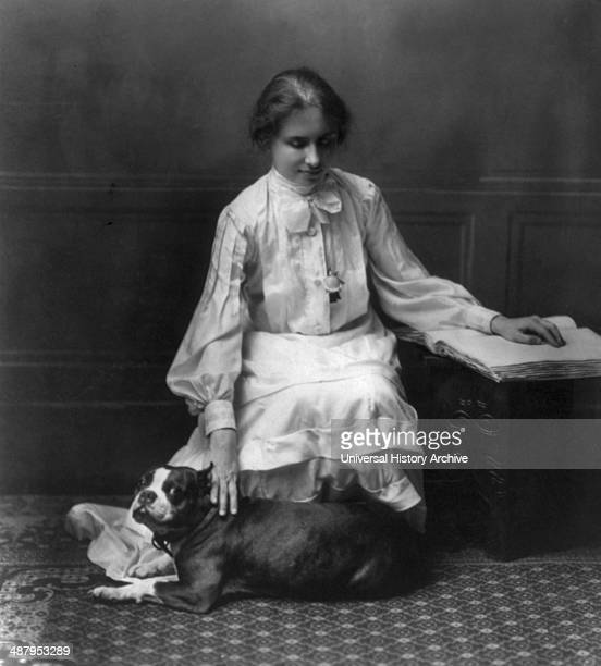Helen Keller 18801968 kneeling facing right right hand on dog left hand on book 1904 Helen Adams Keller American author political activist and...