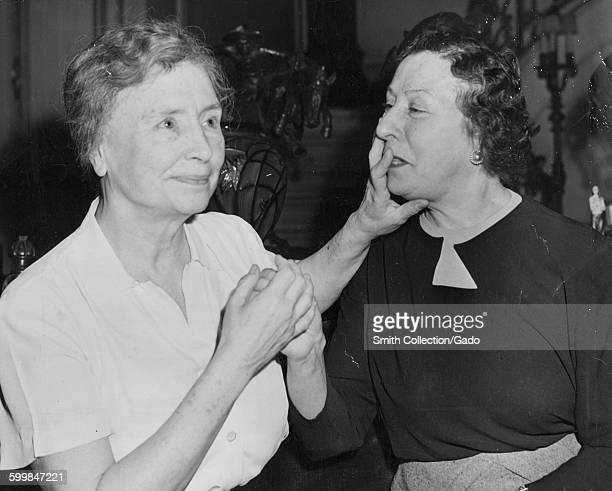 Helen Keller feeling the face of her interpreter, Polly Thompson, Chicago, Illinois, February, 1946.