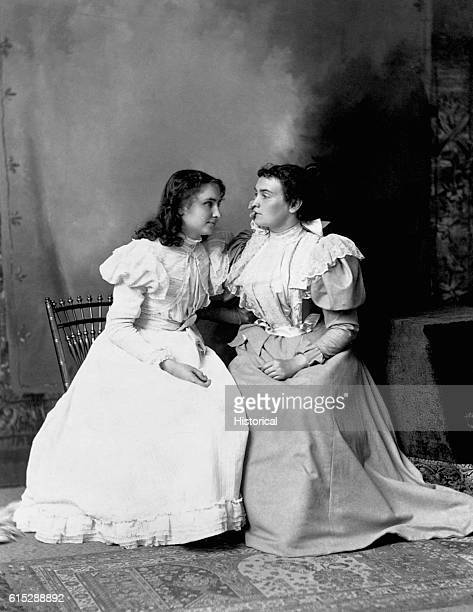 Helen Keller reads the lips of her teacher Anne Sullivan Keller left blind and deaf by scarlet fever at the age of two learned sign and speech from...