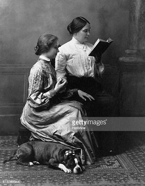 Helen Keller reads with her teacher Anne Sullivan Macy While Keller attended Radcliffe College Macy helped her with her studies by reading books into...
