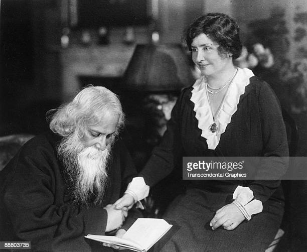 Helen Keller right meets with famous Indian poet Tagore for a photo opportunity in New York in 1930