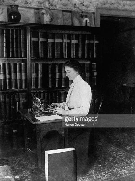 Helen Keller the blind and deaf writer works at her desk 1911