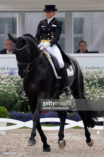 Helen Langehanenberg of Germany and her horse Damon Hill NRW compete in the Deutsche Bank Price freestyle dressage grand prix during day six of the...
