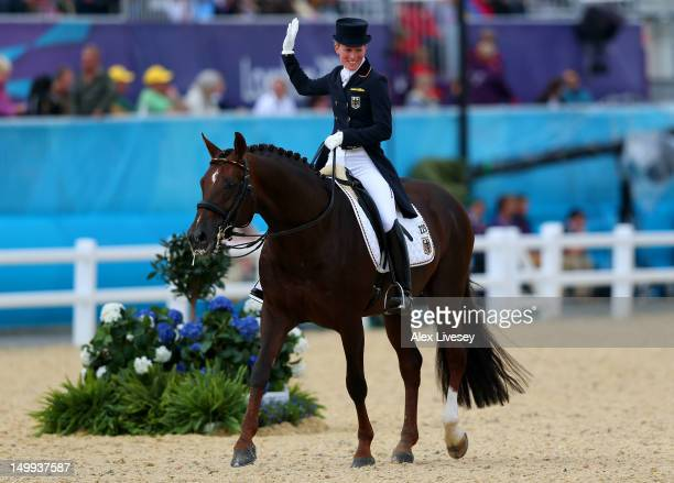 Helen Langehanenberg of Germany riding Damon Hill celebrates after competing in the Team Dressage Grand Prix Special on Day 11 of the London 2012...