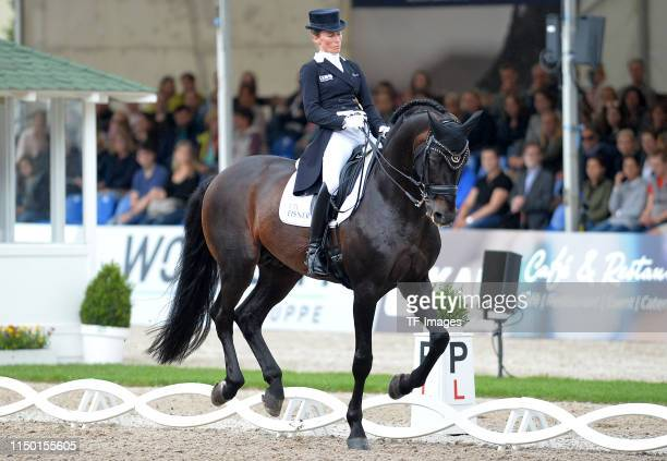 Helen Langehanenberg rides on Dammes FRH during the Longines Balve Optimum dressage competition on June 15 2019 in Balve Germany