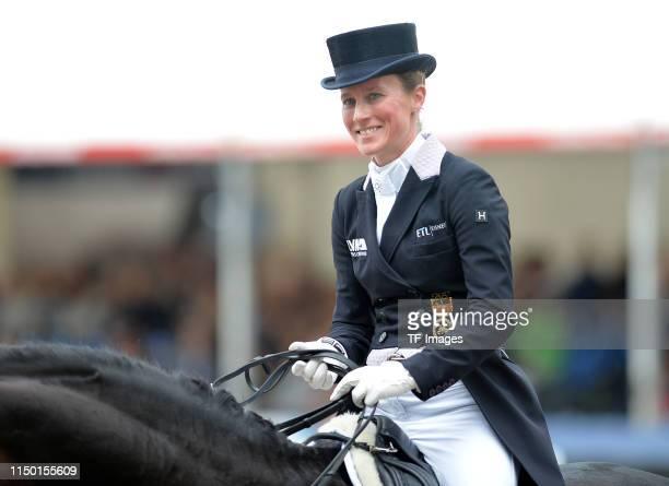 Helen Langehanenberg rides on Dammes FRH laughing during the Longines Balve Optimum dressage competition on June 15 2019 in Balve Germany