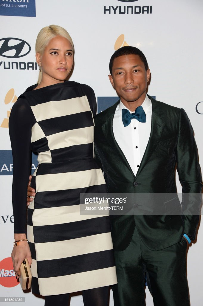 Helen Lasichanh and musician Pharrell Williams arrive at Clive Davis & The Recording Academy's 2013 Pre-GRAMMY Gala and Salute to Industry Icons honoring Antonio 'L.A.' Reid at The Beverly Hilton Hotel on February 9, 2013 in Beverly Hills, California.