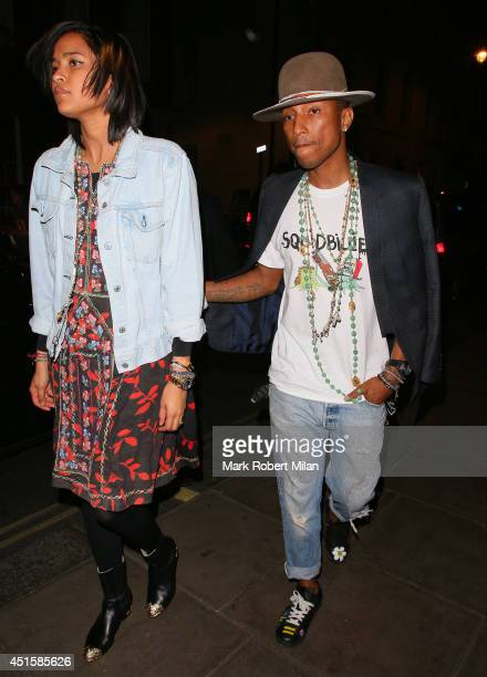 Helen Lasichanh and Pharrell Williams at the Groucho club on July 1 2014 in London England