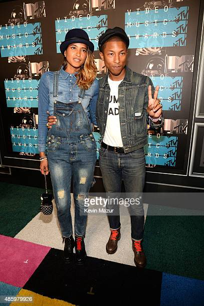 Helen Lasichanh and Pharrell Williams attend the 2015 MTV Video Music Awards at Microsoft Theater on August 30 2015 in Los Angeles California