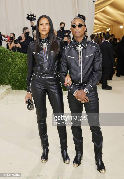 Helen Lasichanh and Pharrell Williams attend The 2021 Met Gala Celebrating In America: A Lexicon Of Fashion at Metropolitan Museum of Art on...