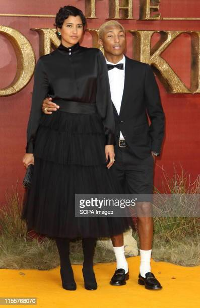 Helen Lasichanh and Pharrell Williams attend the European Premiere of Disney's The Lion King at the Odeon Luxe cinema Leicester Square in London