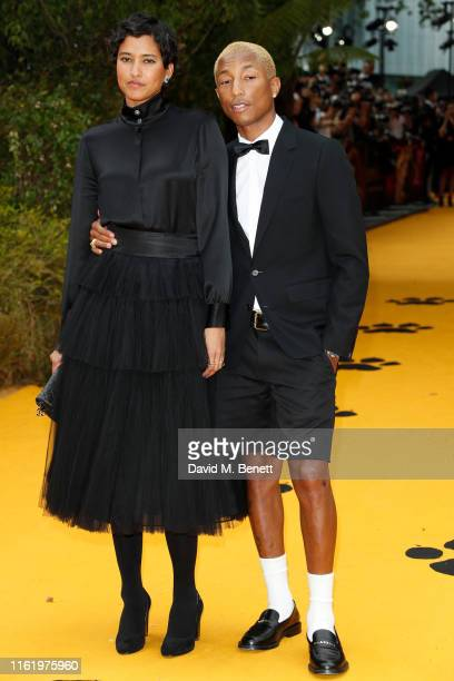 """Helen Lasichanh and Pharrell WIlliams attend the European Premiere of """"The Lion King"""" at Odeon Luxe Leicester Square on July 14, 2019 in London,..."""