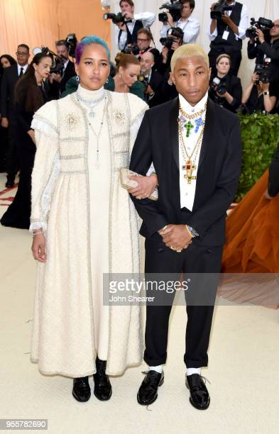 Helen Lasichanh and Pharrell Williams attend the Heavenly Bodies Fashion The Catholic Imagination Costume Institute Gala at The Metropolitan Museum...