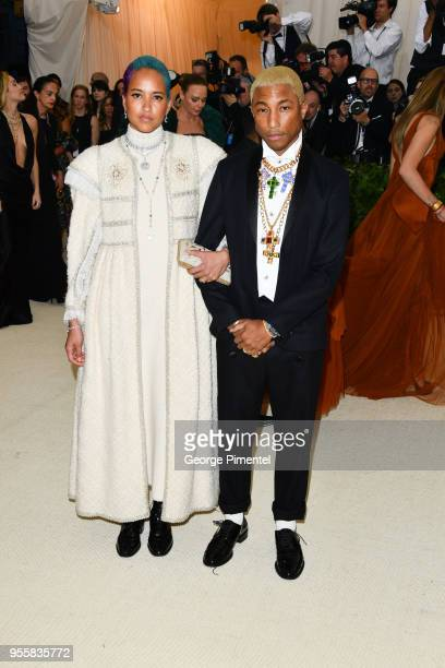 Helen Lasichanh and Pharrell Williams attend the Heavenly Bodies Fashion The Catholic Imagination Costume Institute Gala at Metropolitan Museum of...