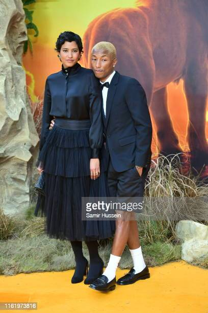 Helen Lasichanh and Pharrell Williams attend The Lion King European Premiere at Leicester Square on July 14 2019 in London England