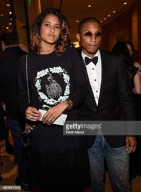 Helen Lasichanh and Pharrell Williams attend the PreGRAMMY Gala And Salute To Industry Icons Honoring Martin Bandier at The Beverly Hilton on...