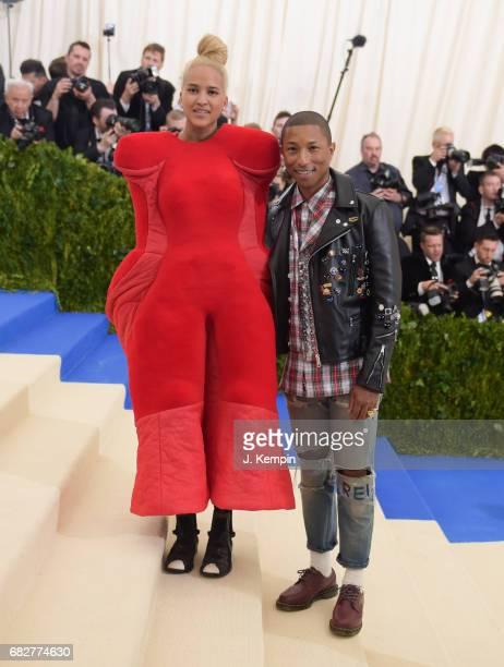 Helen Lasichanh and Pharrell Williams attend the 'Rei Kawakubo/Comme des Garcons Art Of The InBetween' Costume Institute Gala at Metropolitan Museum...