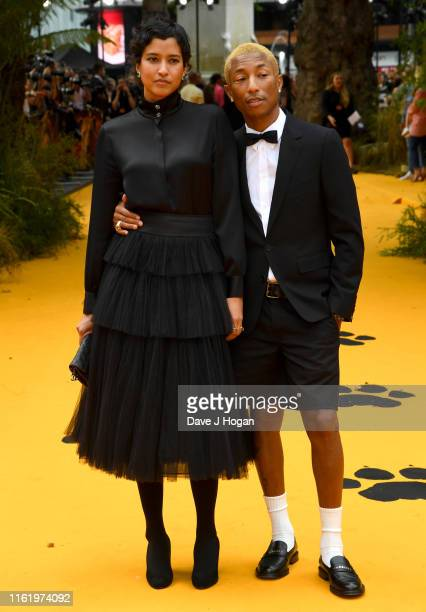 Helen Lasichanh and Pharrell Williams attends The Lion King European Premiere at Leicester Square on July 14 2019 in London England