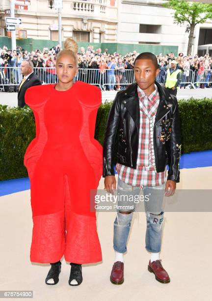 Helen Lasichanh and Pharrell Williams attends the 'Rei Kawakubo/Comme des Garcons Art Of The InBetween' Costume Institute Gala at Metropolitan Museum...