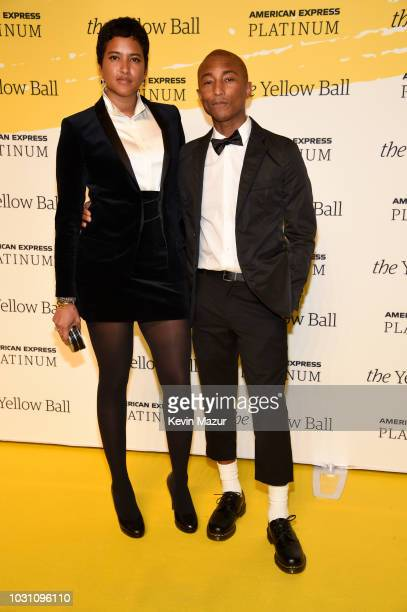 Helen Lasichanh and Pharrell Williams pose on the Yellow carpet at the Yellow Ball hosted by American Express and Pharrell Williams at the Brooklyn...