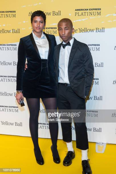 Helen Lasichanh and Singer Pharrell Williams attend the Yellow Ball at the Brooklyn Museum on September 10 2018 in New York City