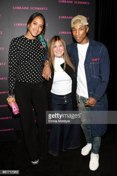 Helen Lasichanh Shelli Azoff and Pharrell Williams attend Lorraine Schwartz launches The Eye Bangle a new addition to her signature Against Evil Eye...