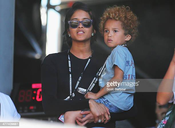 Helen Lasichanh wife of Pharrell Williams holds their son Rocket Man Williams backstage as they watch Pharrell Williams perform live for fans as part...