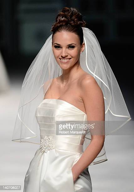 Helen Lindes walks the runway for the new bridal collection 'La Sposa' by the Pronovias Fashion Group at the Palau de Congressos on March 5 2012 in...