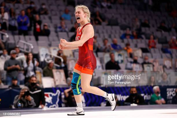 Helen Maroulis celebrates after defeating Jenna Burkert in their Freestyle 62kg finals match on day 2 of the U.S. Olympic Wrestling Team Trials at...