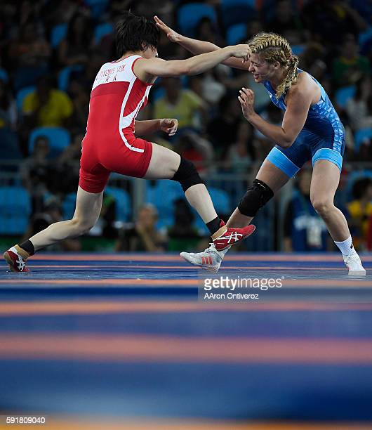 Helen Maroulis of the United States and Jong Myong-suk of North Korea vie for control during women's freestyle wrestling quarterfinal on Thursday,...