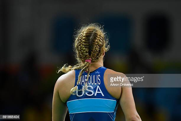 Helen Maroulis of the United States celebrates her win over Jong Myong-suk of North Korea during women's freestyle wrestling quarterfinal on...