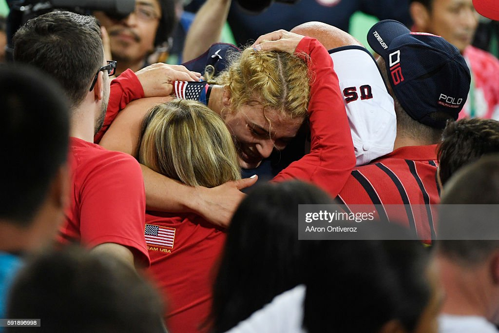 Helen Maroulis of the United States hugs her family Paula (mom) John (dad) and Tony (brother) after defeating Saori Yoshida of Japan during 53kg women's freestyle wrestling title match on Thursday, August 18, 2016. Maroulis defeated Yoshida 4-1 to capture the gold. Yoshida is the world's most decorated wrestler with three Olympic gold medals and 13 world titles.