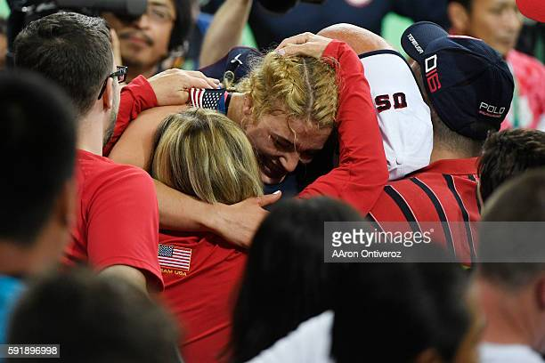 Helen Maroulis of the United States hugs her family Paula John and Tony after defeating Saori Yoshida of Japan during 53kg women's freestyle...
