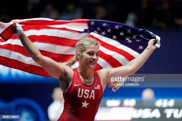 TOPSHOT Helen Maroulis of USA celebrates after she won against Tunisia's Marwa Amri in the women's freestyle wrestling 58kg category final of the...