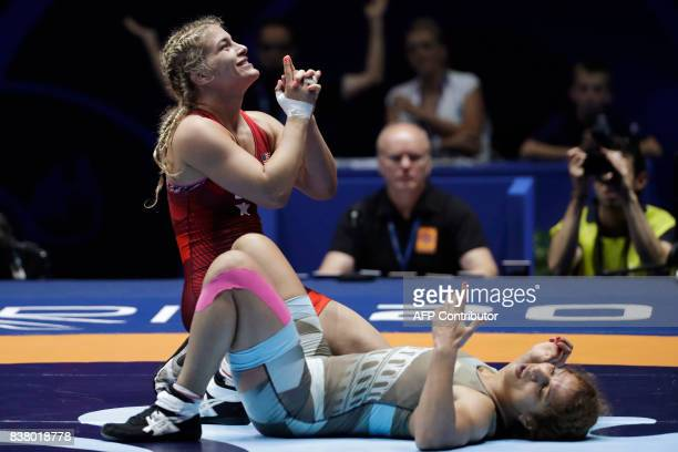 Helen Maroulis of USA celebrates after she won against Tunisia's Marwa Amri in the women's freestyle wrestling 58kg category final of the FILA World...