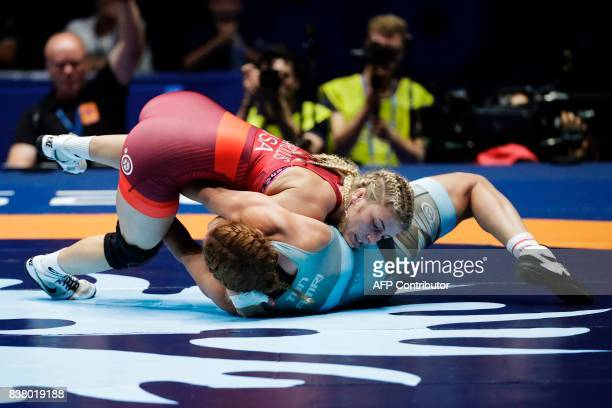 Helen Maroulis of USA competes with Tunisia's Marwa Amri during the women's freestyle wrestling 58kg category final of the FILA World Wrestling...