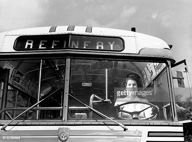 Helen McCabe drives a bus to a refinery in Beaumont Texas May 1943