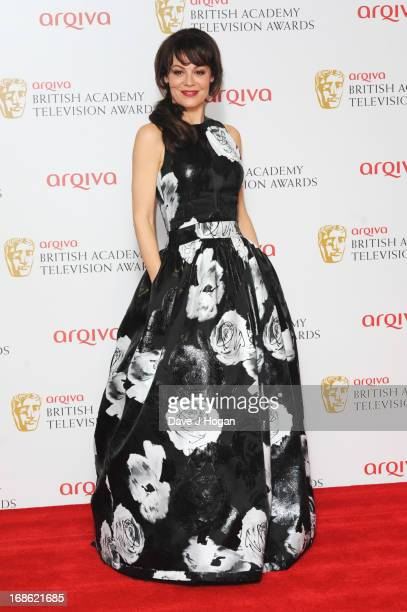 Helen McCrory poses in front of the winners boards at the BAFTA TV Awards 2013 at The Royal Festival Hall on May 12 2013 in London England