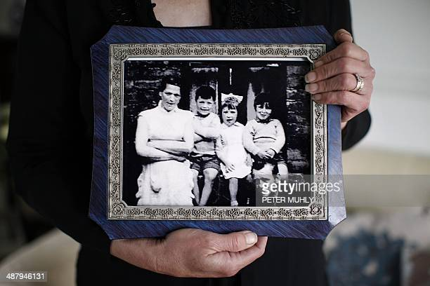 Helen McKendry eldest daughter of murdered woman Jean McConville holds a family photograph showing her mother Jean McConville and some of Jean's...