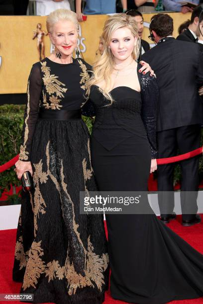 Helen Mirren and Abigail Breslin arrive at the 20th Annual Screen Actors Guild Awards at the Shrine Auditorium on January 18 2014 in Los Angeles...