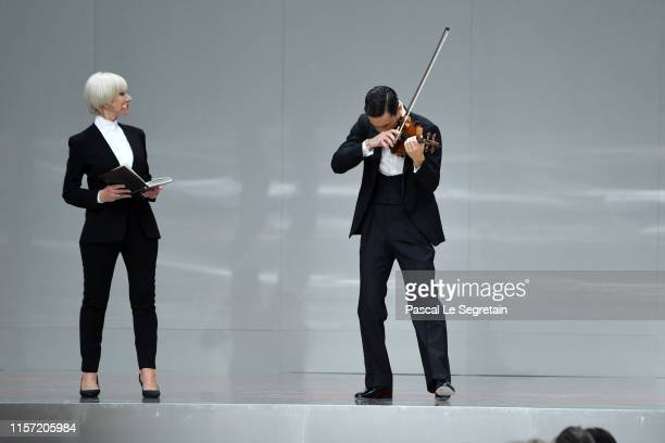 Helen Mirren and Charlie Siem are seen on stage during the Karl Lagerfeld Homage at Grand Palais on June 20, 2019 in Paris, France.