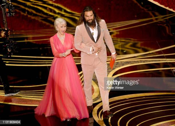 Helen Mirren and Jason Momoa speak onstage during the 91st Annual Academy Awards at Dolby Theatre on February 24 2019 in Hollywood California